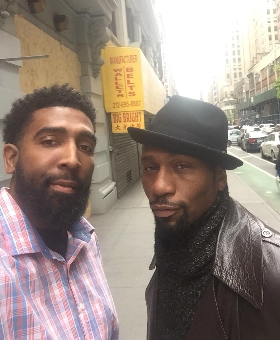 Derrick with Leon Robinson